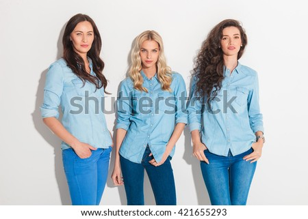 relaxed casual women in jeans clothes standing with hands in pockets in studio