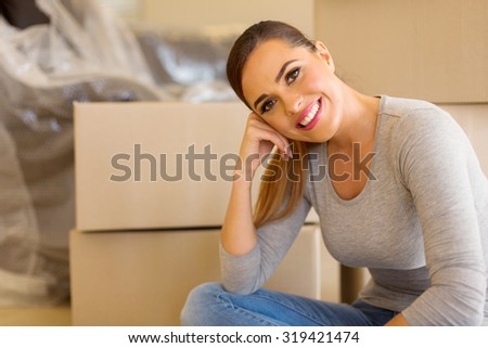 relaxed caucasian girl moving to a new house - stock photo