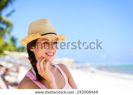 Relaxed charming woman enjoying tropical caribbean vacation at the beach in Playa del Carmen, Riviera Maya, Mexico. Caucasian brunette on vacations looking to side for copy space. - stock photo
