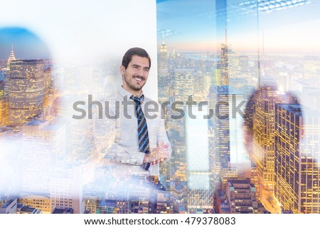 Relaxed cheerful team leader and business owner leading informal in-house business meeting. Business and entrepreneurship concept. New Your city lights reflection in window glass.