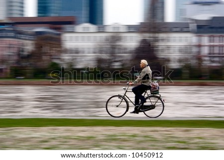 Relaxed city biker. Motion photo - stock photo