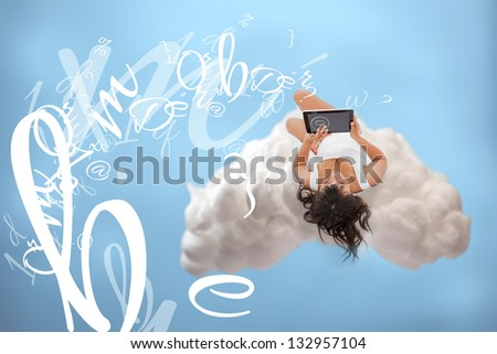 Relaxed girl connecting to cloud computing via digital tablet - stock photo