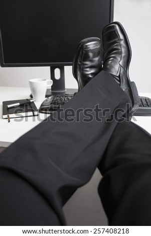 Relaxed leg of a business man - stock photo