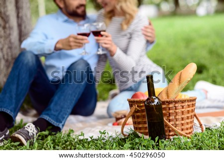 Relaxed lovers enjoying nature and drink