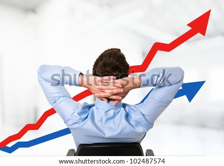 Relaxed man looking at the growth of his business - stock photo