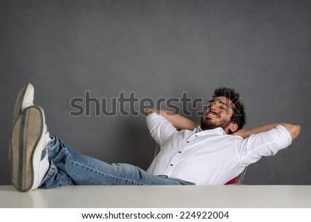Relaxed man portrait over dark grunge background. - stock photo