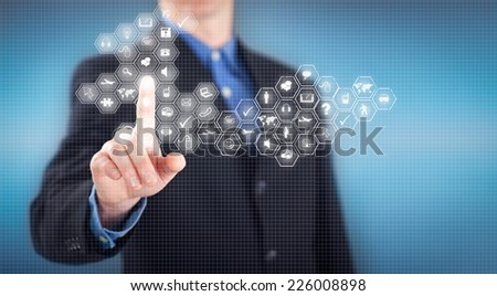relaxed man pressing a button on the virtual keyboard, travel or business concept - stock photo