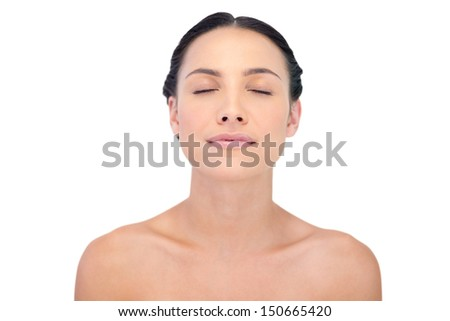 Relaxed natural model posing on white background - stock photo