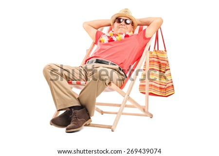 Relaxed senior gentleman with sunglasses sitting in a comfortable sun lounger chair isolated on white background
