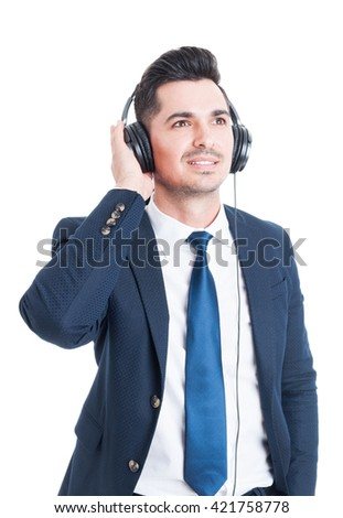 Relaxed smiling businessman or banker resting and enjoying music on headphones isolated on white background - stock photo