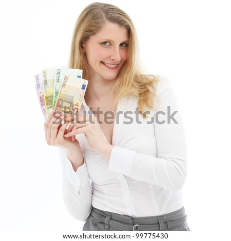 Relaxed wealthy smiling woman holding euro banknotes fanned out in her hand isolated on white