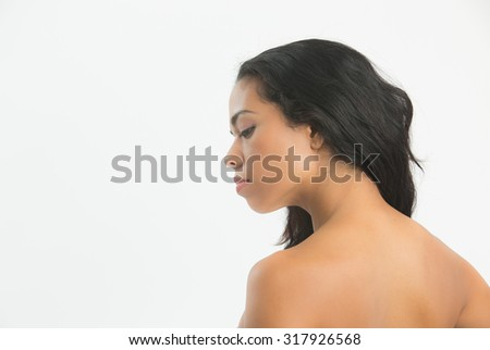 Relaxed woman enjoying and showing  shoulders, back and neck