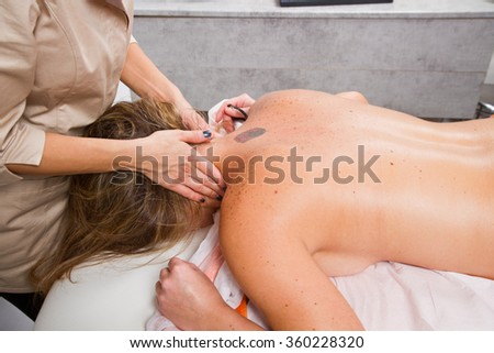 Relaxed woman having a massage in a beauty center