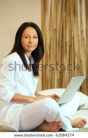 Relaxed woman in front of a laptop computer