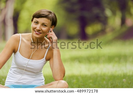 Relaxed woman listening music smiling.