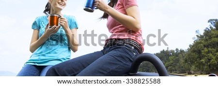 relaxed woman on summer travel vacation to the coast leaning out car sunroof  - stock photo