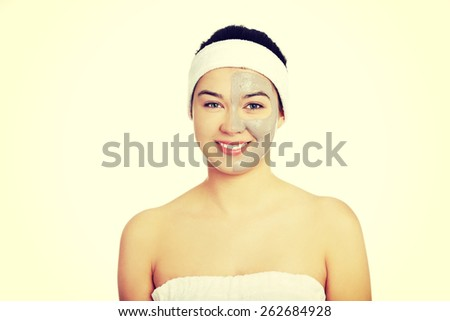 Relaxed woman with  a deep cleansing nourishing face mask applied to her face, beauty and skincare concept - stock photo