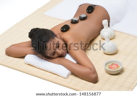 Relaxed women at SPA. Top view of beautiful young women lying on front with SPA stones on her back