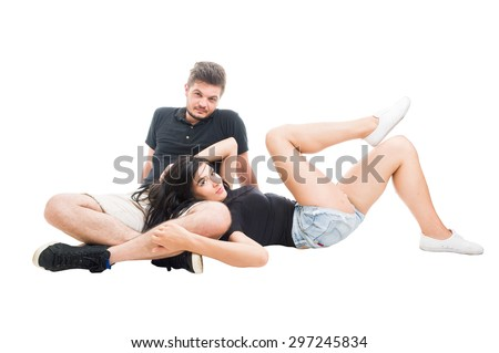 Relaxed young and happy couple sitting on white floor and girlfriend is resting her head on boyfriend lap - stock photo