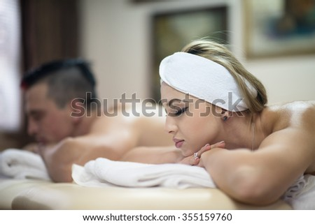 relaxed young couple getting massage in spa and wellness salon - stock photo