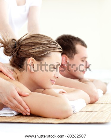 Relaxed young couple receiving a back massage in a spa center
