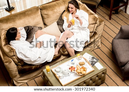 Relaxed young female friends , aerial view. - stock photo