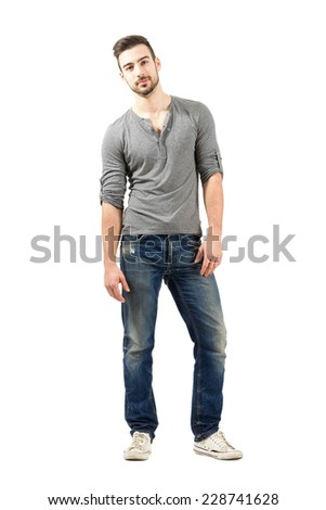 Relaxed young male model posing.  Full body length isolated over white background. - stock photo