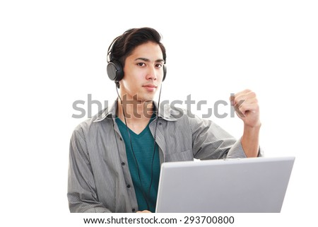 Relaxed young man at home - stock photo