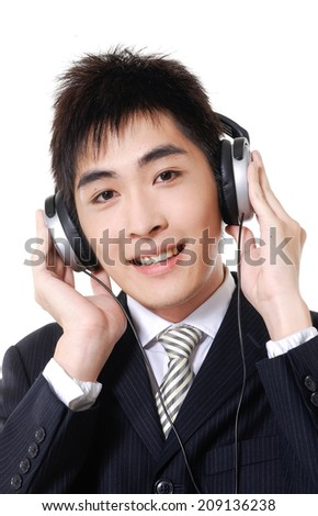Relaxed young smiling male listening to music - stock photo