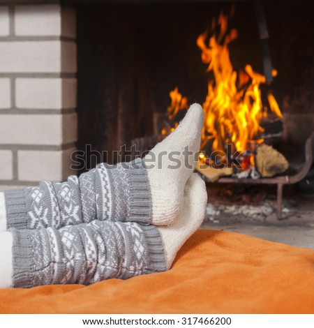 relaxing at fireplace at home - stock photo