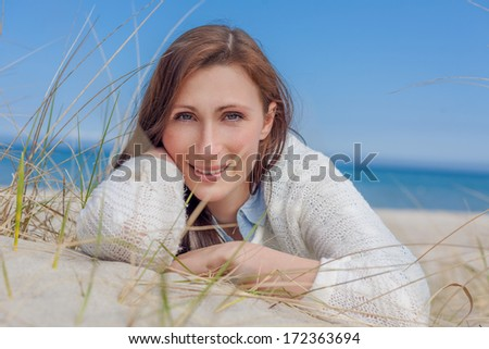 relaxing autumn spring female on coast - stock photo