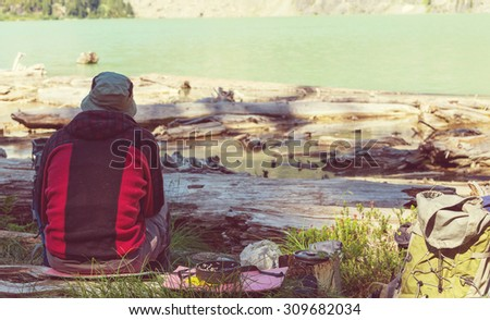 Relaxing backpackers  in mountains. Instagram filter. - stock photo