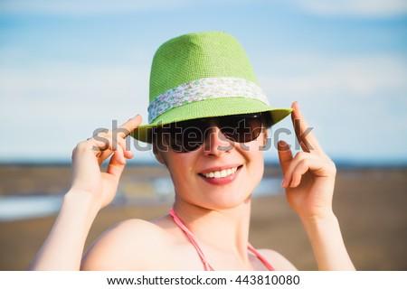 Relaxing beach woman enjoying the summer sun. - stock photo