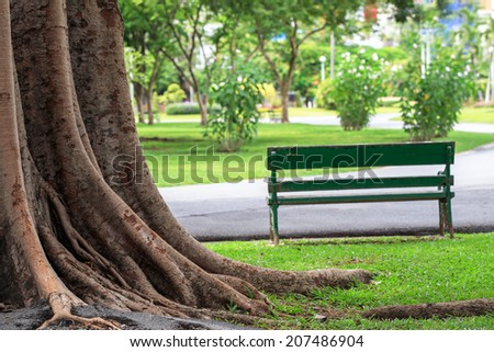 Relaxing bench, chair, stool beside walkway in the public park, wait for resting people - stock photo