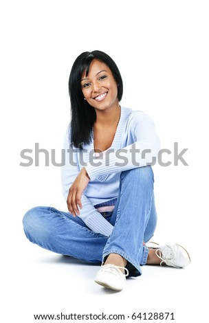 Relaxing black woman sitting on floor isolated on white background