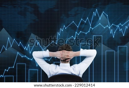 Relaxing businessman and rising stock market  - stock photo