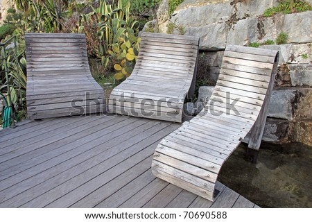 Relaxing chairs in the garden - stock photo