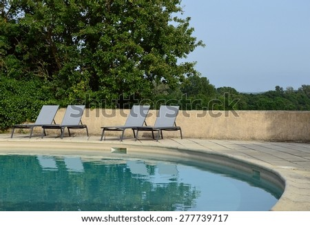 Relaxing chairs near the swimming pool