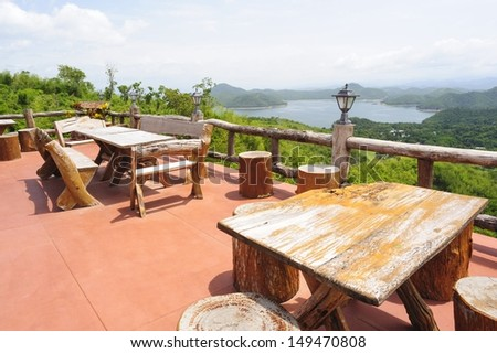 Relaxing conner on the terrace near lake. - stock photo