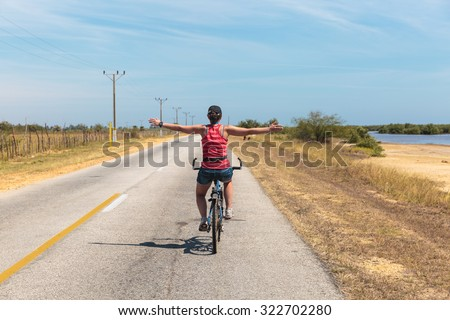 Relaxing cycling on the road of Trinidad, Cuba - stock photo