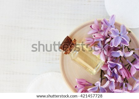 Relaxing essential oil, fresh flowers, relaxation setting, top view. - stock photo