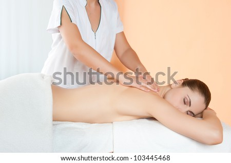 Relaxing hand massage on back at beauty spa salon - stock photo