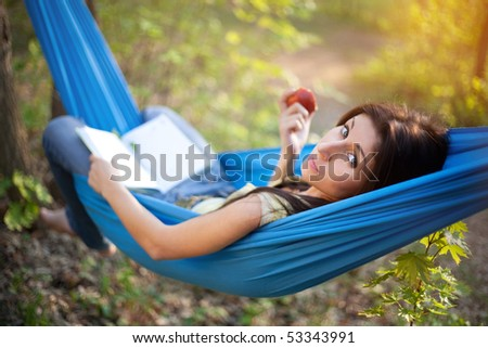 Relaxing in a Hammock - stock photo
