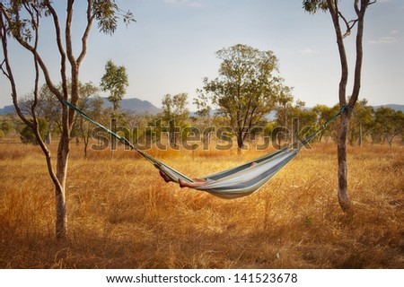 Relaxing in a hammock in the Australian outback. - stock photo
