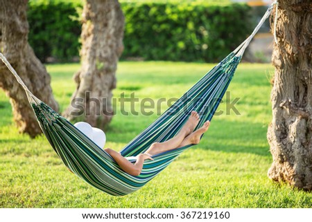 Relaxing in the hammock. Summer day. - stock photo