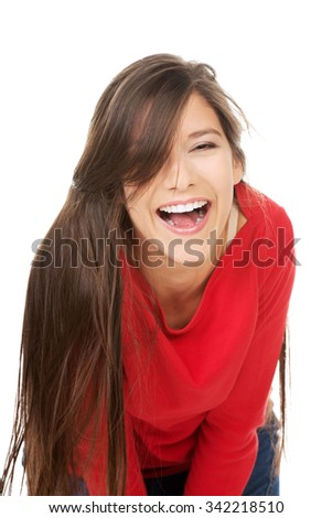 Relaxing laughing student woman sitting on the floor. - stock photo