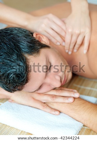 Relaxing man enjoying wellbeing wellness spa therapy - stock photo