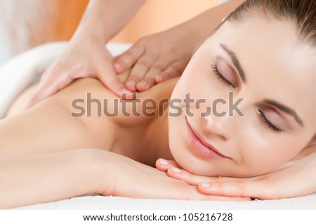 Relaxing massage at beauty spa salon - stock photo