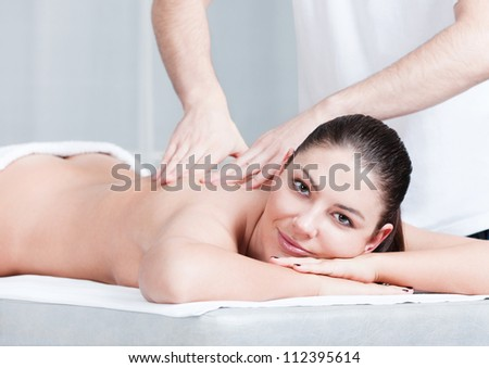 Relaxing massage for woman at beauty spa salon - stock photo