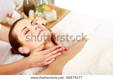 Relaxing massage for young beautiful woman in the spa salon